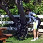 Susan preparing her bike in the picnic area behind the Pescadero Bakery