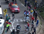 Andy Schleck during his dramatic stage finish, riding over &quot;Schleck Attack&quot; written on the pavement