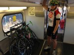 On CalTrain, bikes are held against the wall by bungee cords. Not elegant, and when it's busy, not easy on the bikes. But it works.