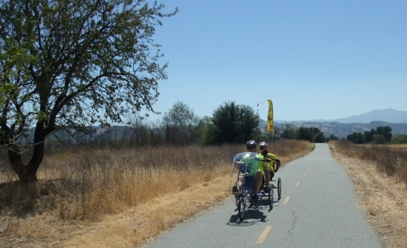 "An ""older"" couple on a 3-wheel recumbent"