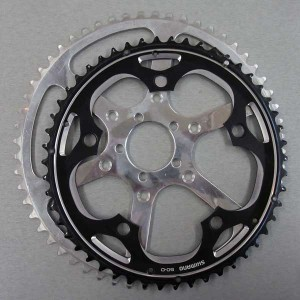 Which chainring will make you go faster, the larger one or the smaller one (which came stock on your bike)? Answer: The smaller one.